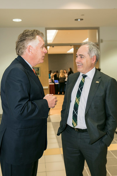 President Ángel Cabrera (right) welcomes Former Virginia Gov. Terry McAuliffe, who joined Mason as a Distinguished Visiting Professor at the Schar School.  Photo by:  Ron Aira/Creative Services/George Mason University