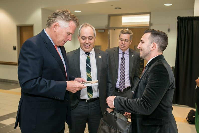 President Ángel Cabrera and Schar School of Policy and Assistant Professor of Public Policy Justin Gest (right) welcome Former Virginia Gov. Terry McAuliffe, who joined Mason as a Distinguished Visiting Professor at the Schar School.  Photo by:  Ron Aira/Creative Services/George Mason University