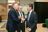 Provost and Executive Vice President S. David Wu welcomes Former Virginia Gov. Terry McAuliffe, who joined Mason as a Distinguished Visiting Professor at the Schar School, as President Ángel Cabrera looks on.  Photo by:  Ron Aira/Creative Services/George Mason University