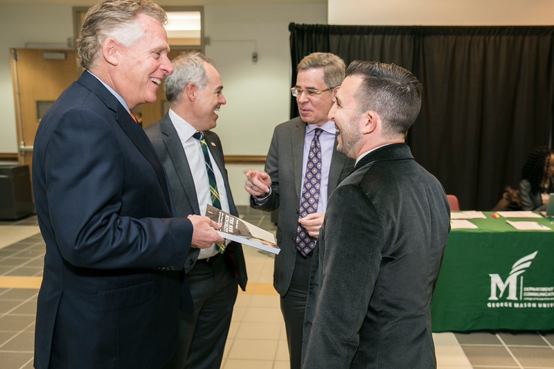 President Ángel Cabrera, Schar School of Policy and Government Dean Mark Rozell, Schar School of Policy and Assistant Professor of Public Policy Justin Gest welcome Former Virginia Gov. Terry McAuliffe, who joined Mason as a Distinguished Visiting Professor at the Schar School.  Photo by:  Ron Aira/Creative Services/George Mason University