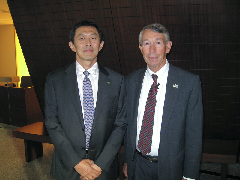 S. David Wu (on left), Provost and Executive Vice President, and Stephen Fuller, University Professor, Director, Center for Regional Analysis, attend the Summer Economic Forum 2014, co-hosted by George Mason's Center for Regional Analysis and Capital One. Photo by Buzz McClain
