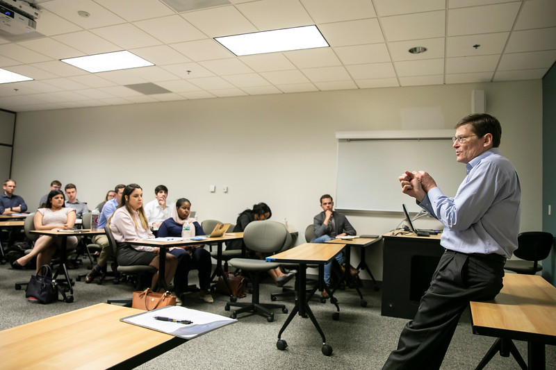 Former acting CIA director Mike Morell now a Distinguished Visiting Professor at the the Schar School lectures public policy students on briefing decision-makers.   Photo by:  Ron Aira/Creative Services/George Mason University