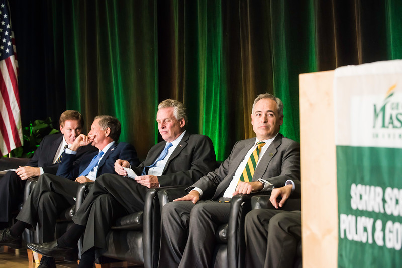 Tom Davis, Rector, George Mason University Board of Visitors, The Honorable John R. Kasich, Governor of Ohio, The Honorable Terence McAuliffe, Governor of Virginia, and Ángel Cabrera, President, George Mason University, during the the Schar School of Policy and Government Dedication.  Photo by Ron Aira/Creative Services/George Mason University