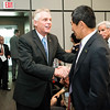 The Honorable Terence McAuliffe greets Provost, David Wu, George Mason University at  the Schar School of Policy and Government Dedication.  Photo by:  Ron Aira/Creative Services/George Mason University