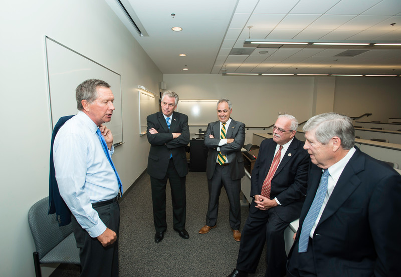 (Left to right) The Honorable John R. Kasich, Governor of Ohio, The Honorable Terence McAuliffe, Governor of Virginia, Ángel Cabrera, President, George Mason University, Gerry Connolly,  United States Representative, VA 11th District, and Dwight C. Schar before the Schar School of Policy and Government Dedication.  Photo by Ron Aira/Creative Services/George Mason University