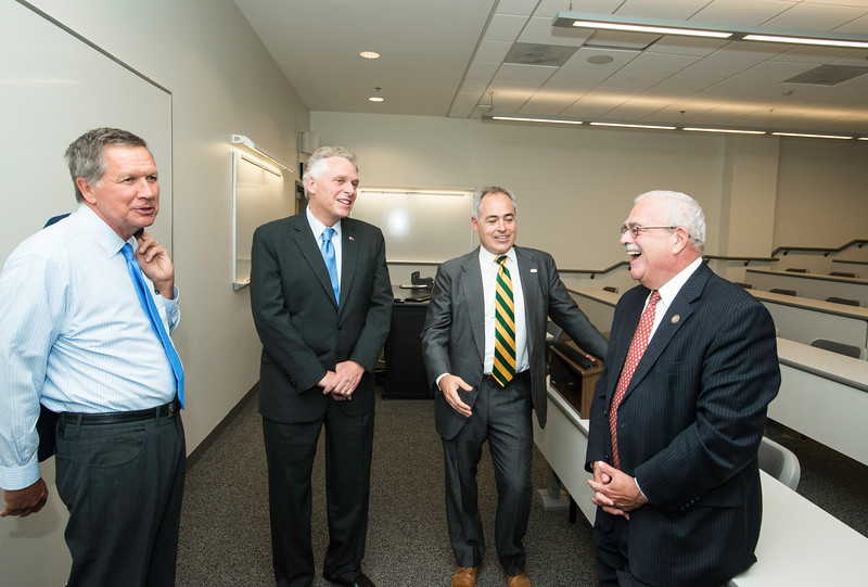 The Honorable John R. Kasich; Governor of Ohio; The Honorable Terence McAuliffe; Governor of Virginia; Ángel Cabrera; President; George Mason University; and Gerry Connolly; United States Representative; VA 11th District at the Schar School of Policy and Government Dedication.  Photo by:  Ron Aira/Creative Services/George Mason University