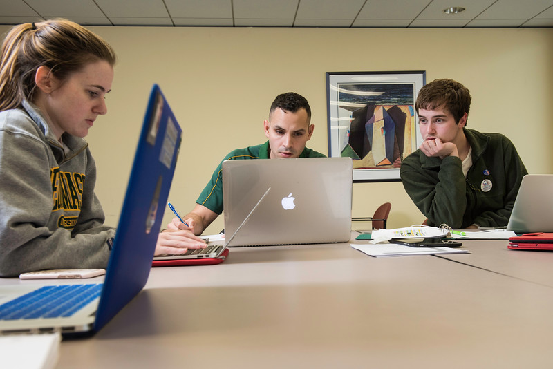 Mason government students at the HUB collect incoming data send by exit pollsters in a project to predict and analyze voting outcomes.  Photo by Ron Aira/Creative Services/George Mason University