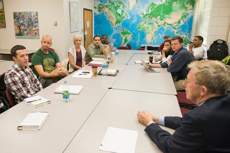 An MPA cohort, part of the Northern Virginia Public Service Fellows program, meet for class in Robinson Hall. Photo by Alexis Glenn/Creative Services/George Mason University