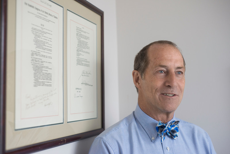 Professor Frank Shafroth speaks about a bill on bankruptcy protection for municipalities he wrote, in his office at the Arlington Campus. Photo by Alexis Glenn/Creative Services/George Mason University