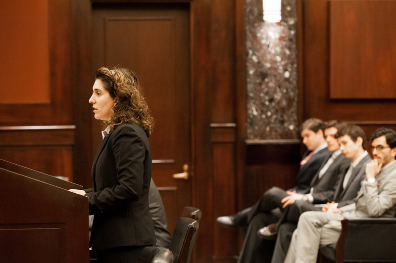 """Law School students listen as student and """"plaintiff"""" Azadeh Malek presents her case at the Law School's final round of the First Year Moot Court Competition at US District Court, Eastern District of Virginia, in Alexandria. Photo by Alexis Glenn/Creative Services/George Mason University"""