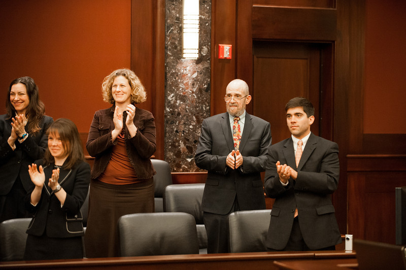 Law School faculty and staff applaud competitors at the Law School's final round of the First Year Moot Court Competition at US District Court, Eastern District of Virginia, in Alexandria. Photo by Alexis Glenn/Creative Services/George Mason University