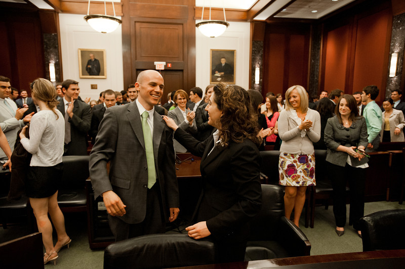 "Law School students and ""defendant"" Timothy Cronin and ""plaintiff"" Azadeh Malek hug after they competed in the Law School's final round of the First Year Moot Court Competition at US District Court, Eastern District of Virginia, in Alexandria. Photo by Alexis Glenn/Creative Services/George Mason University"