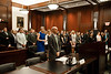 "Law School students, ""defendant"" Timothy Cronin and ""plaintiff"" Azadeh Malek stand for the departure of the judges during a recess at the Law School's final round of the First Year Moot Court Competition at US District Court, Eastern District of Virginia, in Alexandria. Photo by Alexis Glenn/Creative Services/George Mason University"