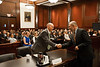 "Law School student and ""defendant"" Timothy Cronin shakes hands with Law School Dean Daniel Polsby after he competed in the Law School's final round of the First Year Moot Court Competition at US District Court, Eastern District of Virginia, in Alexandria. Photo by Alexis Glenn/Creative Services/George Mason University"