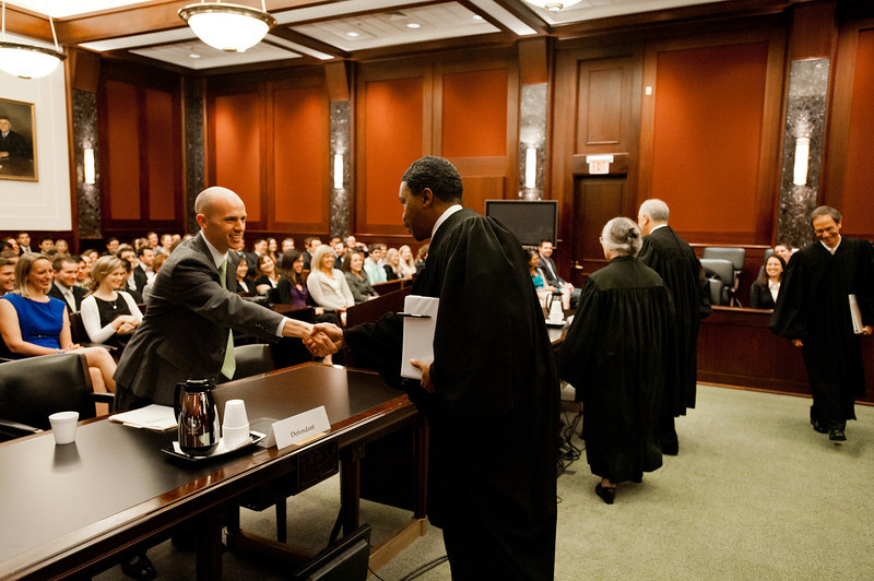 """Law School student and """"defendant"""" Timothy Croninafter shakes hands with District Court Judges after he competed in the Law School's final round of the First Year Moot Court Competition at US District Court, Eastern District of Virginia, in Alexandria. Photo by Alexis Glenn/Creative Services/George Mason University"""