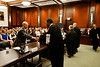 "Law School student and ""defendant"" Timothy Croninafter shakes hands with District Court Judges after he competed in the Law School's final round of the First Year Moot Court Competition at US District Court, Eastern District of Virginia, in Alexandria. Photo by Alexis Glenn/Creative Services/George Mason University"