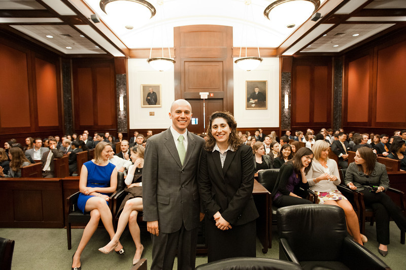 "Law School students and ""defendant"" Timothy Cronin and ""plaintiff"" Azadeh Malek smile after they competed in the Law School's final round of the First Year Moot Court Competition at US District Court, Eastern District of Virginia, in Alexandria. Photo by Alexis Glenn/Creative Services/George Mason University"