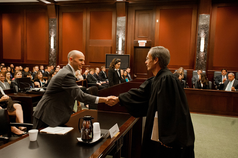 "Law School student and ""defendant"" Timothy Cronin shakes hands with a District Court Judge after he competed in the Law School's final round of the First Year Moot Court Competition at US District Court, Eastern District of Virginia, in Alexandria. Photo by Alexis Glenn/Creative Services/George Mason University"