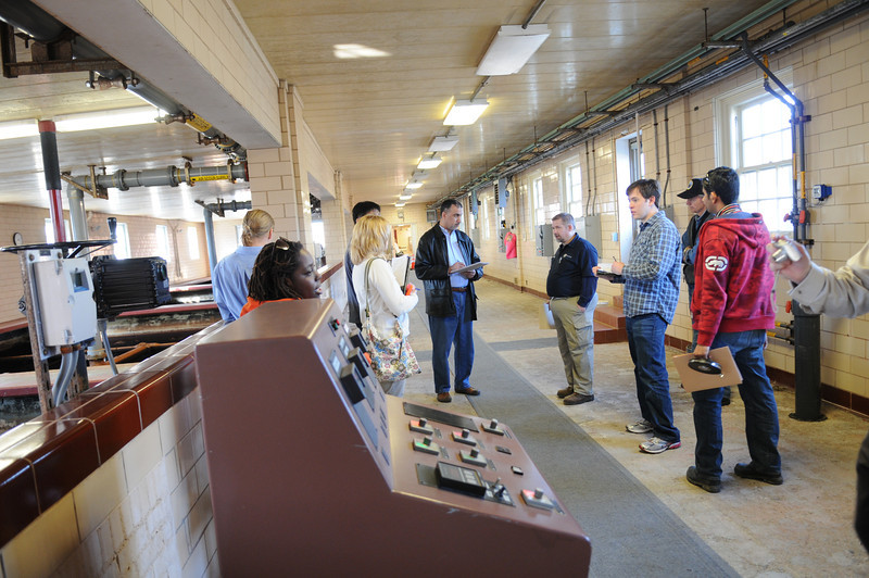 Students tour a water treatment plant with part-time faculty member Dave Binning. Photo by Evan Cantwell/Creative Services/George Mason University