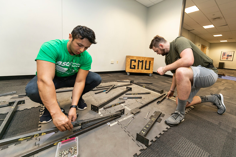 Engineering students practice building a steel bridge prior to the ASCE Competition, held at Mason this year.  Photo by:  Ron Aira/Creative Services/George Mason University