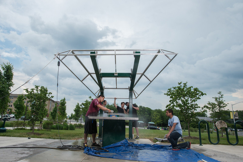 Engineering students work with the Office of Sustainability to build a solar panel power charging station on campus.