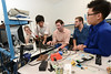 Engineering students design an anti-stutter microcontroller device under the guidance of Nathalia Peixoto, assistant professor of electrical and computer engineering, and James Brinton, a speech language pathologist at the Katherine Thomas School in Rockville, Md. Pictured left to right: Jon Posey, Steve Lim, Jim Beatty, Thomas Parnell and JS Ham. Photo by Evan Cantwell/Creative Services/George Mason University
