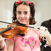 A five-person senior design team of bioengineering majors in Mason's Volgeneau School are creating a prosthetic left arm for Isabella Nicola so she can play the violin. Isabella was born with only half her left arm. She became known to Mason through her music teacher at Island Creek Elementary School, Matthew Baldwin, a Mason graduate.  Photo by:  Ron Aira/Creative Services/George Mason University