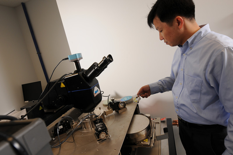 QiLiang Li measuring silicon nanowire field effect transistor on silicon wafer. Photo by Evan Cantwell/Creative Services/George Mason University