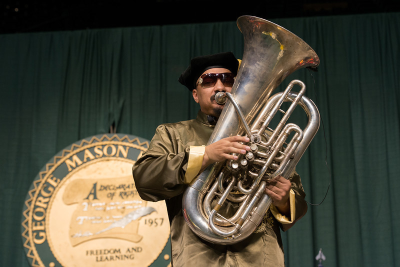 "Director of Athletic Bands Michael ""Doc Nix"" Nickens performs at the Volgenau School of Engineering Convocation 2012. Photo by Alexis Glenn/Creative Services/George Mason University"