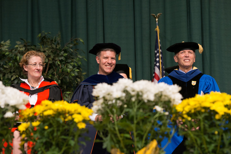 "Professors smile as the listen to Dean Lloyd Griffiths and Director of Athletic Bands Michael ""Doc Nix"" Nickens perform at the Volgenau School of Engineering Convocation 2012. Photo by Alexis Glenn/Creative Services/George Mason University"