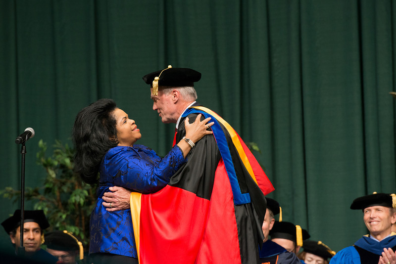 Dean Lloyd Griffiths hugs Patricia Miller after she sang the National Anthem at the Volgenau School of Engineering Convocation 2012. Photo by Alexis Glenn/Creative Services/George Mason University