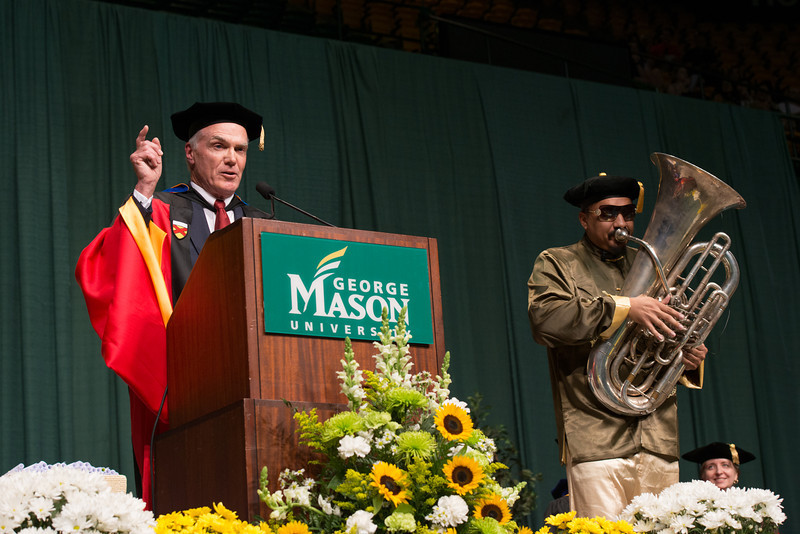 "Dean Lloyd Griffiths and Director of Athletic Bands Michael ""Doc Nix"" Nickens perform at the Volgenau School of Engineering Convocation 2012. Photo by Alexis Glenn/Creative Services/George Mason University"