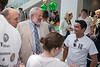 Dean of the Volgenau School of Engineering Ken Ball greets students at an ice cream social in the atrium of the Nguyen Engineering Building at Fairfax Campus. Photo by Alexis Glenn/Creative Services/George Mason University