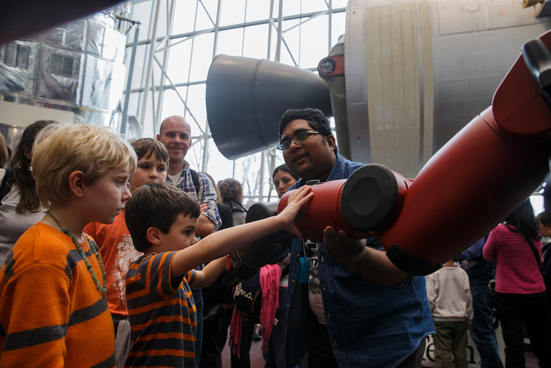 George Mason University PhD student Kazi Mohammad Razin Anik shows off Baxter, the research robot, during Smithsonian Robotics Exhibition at the Smithsonian National Air and Space Museum on April 3, 2015. Photo by Craig Bisacre/Creative Services/George Mason University