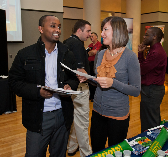 Mason students seek out job opportunities and meet potential employers at Volgenau School's Engineers Day in Dewberry Hall at Fairfax Campus. Photo by Alexis Glenn/Creative Services/George Mason University