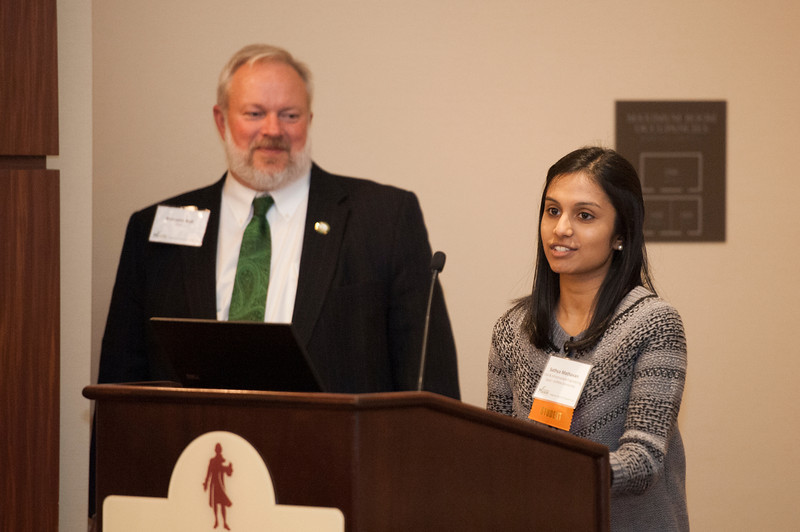 Sathya Mathavan, a Civil, Environmental, and Infrastructure Engineer major and the first winner of the Lloyd J. Griffiths Endowed Scholarship, speaks, as Dean Ken Ball looks on, at the Volgenau School of Engineering Best and Brightest Luncheon at Fairfax campus. Photo by Alexis Glenn/Creative Services/George Mason University