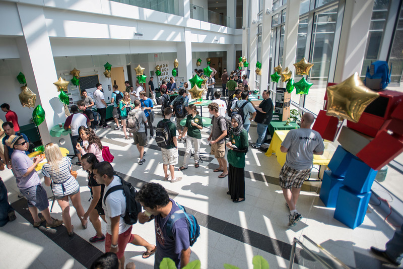 Students of the Volgenau School of Engineering attend an ice cream social in the atrium of the Nguyen Engineering Building at Fairfax Campus. Photo by Alexis Glenn/Creative Services/George Mason University
