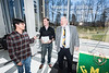 Associate Professor Dan Lofaro and Dean Kenneth Ball award prizes after the Zipline Egg Drop during Engineers Week at Volgenau School of Engineering.  Photo by Ron Aira/Creative Services/George Mason University