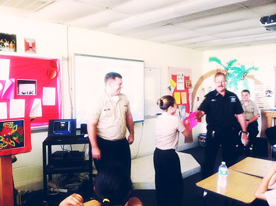 Forensic Specialist Detwiler demonstrating the use of friction ridges with LT Singleton and cadet A. Lorusso.