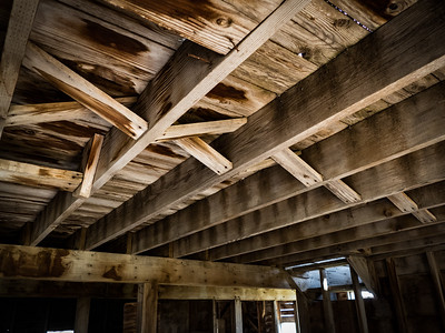 Still-solid bridging supports the loft floor above.