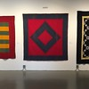 Three IQSC Amish quilts.
