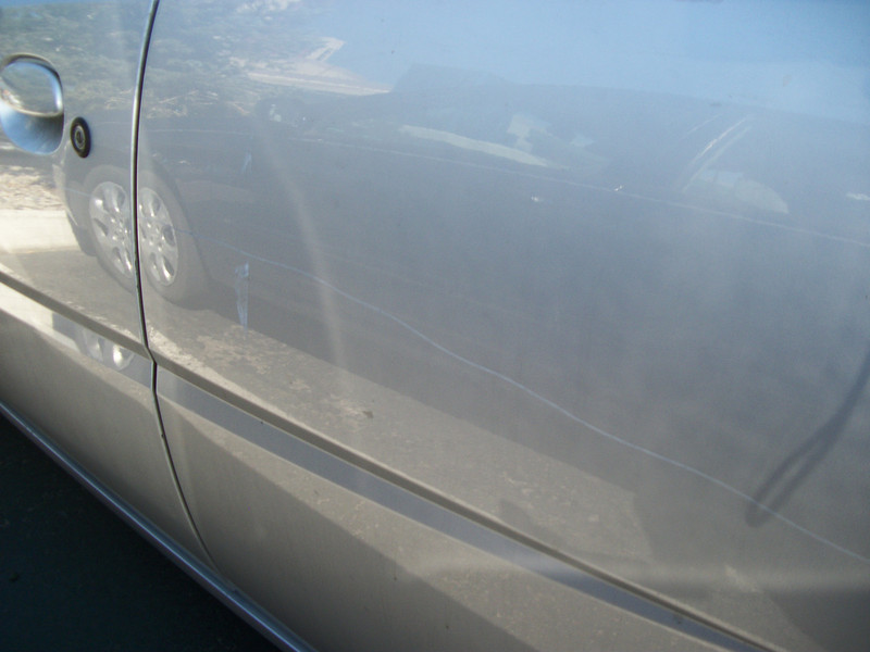got to my car after Costume Contest at Reno's Peppermill and found that someone had keyed the driver's side of my car.