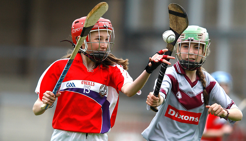 EEXXjob SPORT 30/05/2017 Sciath na Scol Finals played at Pairc Ui Rinn.  Cloghroe v GS Uí Riordáin. Aisling O'Keefe Cloghroe eyes up the ball watched by Sorcha Nic Chárthaigh.       Picture: Andy Jay