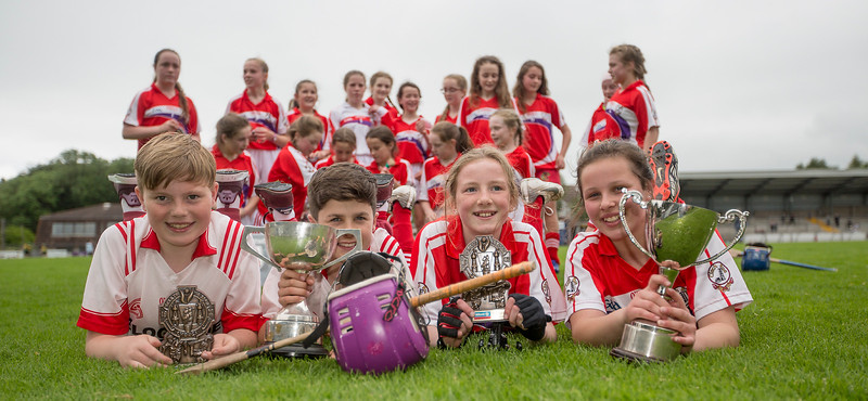 EEXXjob SPORT 30/05/2017 Sciath na Scol Finals played at Pairc Ui Rinn.  Cloghroe boys and girls celebrate their victories at Pairc Ui Rinn l-r Ross O'Donovan Vice Captain,  Captain David Keane, Andie O'Sullivan Vice Captain and Captain, Aoibhe Murphy.  Picture: Andy Jay
