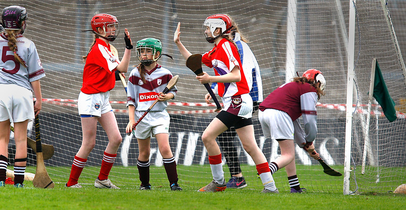 EEXXjob SPORT 30/05/2017 Sciath na Scol Finals played at Pairc Ui Rinn.  Cloghroe v GS Uí Riordáin.  On pitch celebration of a further goal .  Jessica Lyne and Andie O'Sullivan high five each other.  Picture: Andy Jay