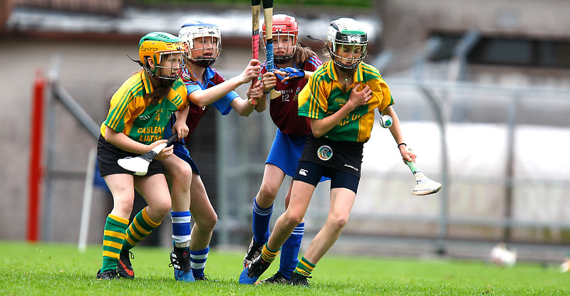EEXXjob SPORT 30/05/2017 Sciath na Scol Finals played at Pairc Ui Rinn. C5 Berrings v Castlelyons .   Liah Halliham Castlelyons stuggles to keep possession under pressure from Malvina Kempa and partner.  Picture: Andy Jay