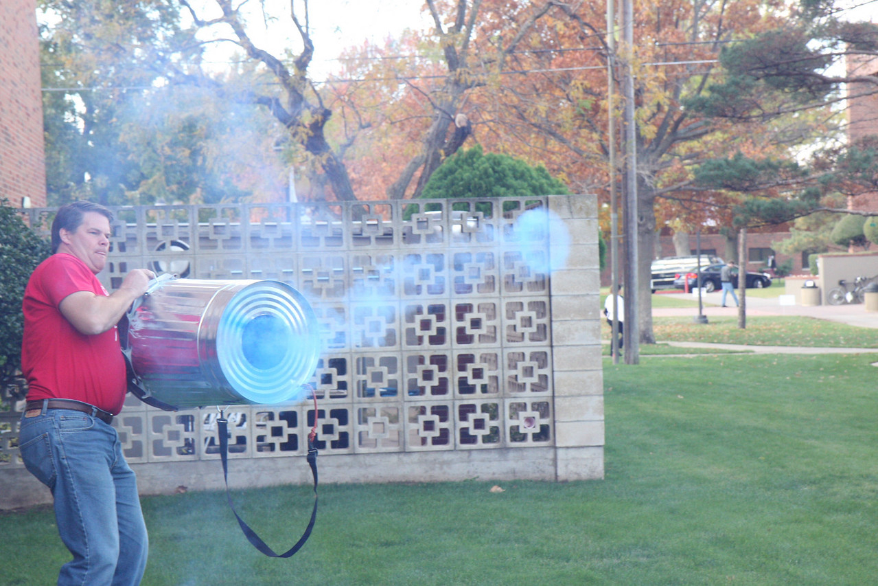 Dr. Winslow makes smoke rings outside with the air cannon.