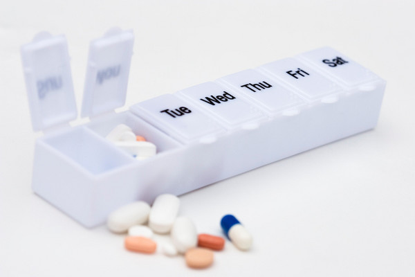 Polypharmacy and compliance. People with several chronic diseases will be taking many pill each day. Labelled pill boxes are used to help patients with drug compliance.