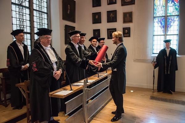 Dr. Brenny receiving his diploma