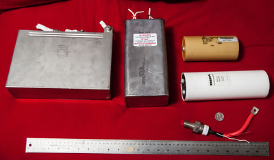 A small selection of capacitors. From L to R: ICAR Bioenergy, Italy. 6uF, 2kV, polypropylene. 12 joules. Ultra low ESR & ESL. Aerovox Energy Discharge. Defib. 224uF, 1.5kV. Castor Oil. 252 joules (!) EPCOS polypropylene, 1.7kV, 10uF. Even lower ESR. Used for motor drive snubbing, etc. 14 joules.  RIFA PEH200YX460BQ aluminum electrolytic. 6mF. 450vdc. 7 milliohms ESR. 607.5 joules. (For scale, a joule is the energy it takes to lift an apple 1 meter. A pair of these EPCOS capacitors could take a similar 100g object and lift it to a height of over a kilometer rather quickly if coupling was good.)